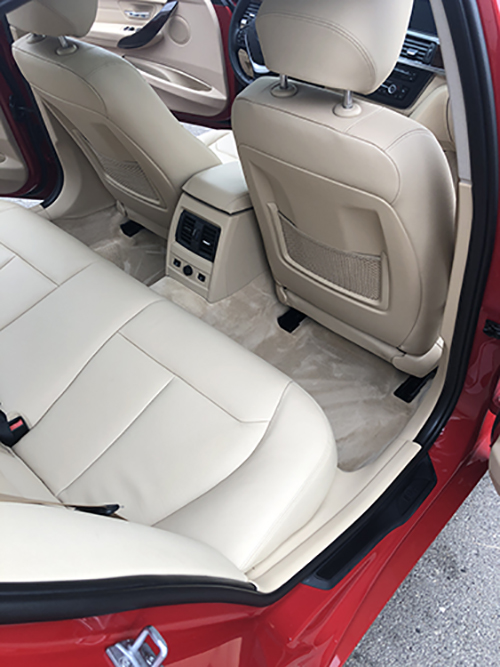 Red BMW interior with glossy detailed seats.