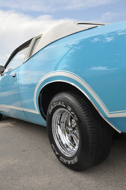 Classic baby blue car with exterior detail.