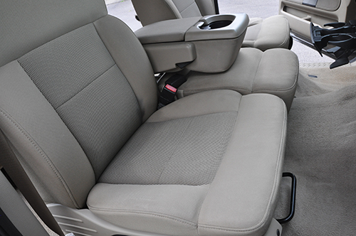 Interior detail with shampooed seats using hot water extraction.