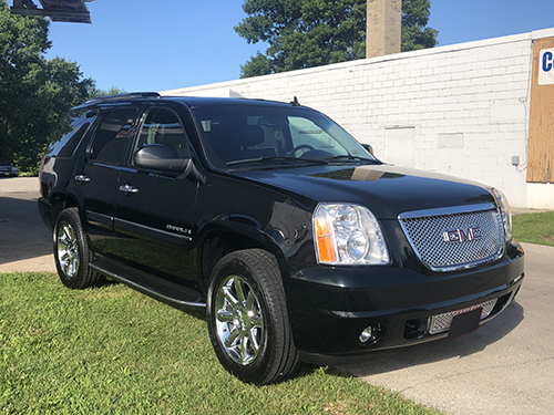 Black SUV with exterior deluxe detail.