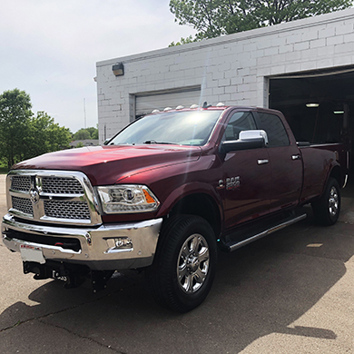 Maroon truck with deluxe exterior detail.